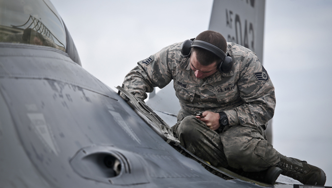 A New Jersey National Guard Airman works on an F-16D Fighting Falcon from the 177th Fighter Wing prior to a mission during a three-day Aeropsace Control Alert CrossTell live-fly training exercise at Atlantic City Air National Guard Base, N.J., May 24, 2017. Representatives from the Air National Guard fighter wings, Civil Air Patrol, and U.S. Coast Guard rotary-wing air intercept units will conduct daily sorties from May 23-25 to hone their skills with tactical-level air-intercept procedures. (U.S. Air National Guard photo by Master Sgt. Matt Hecht/Released)